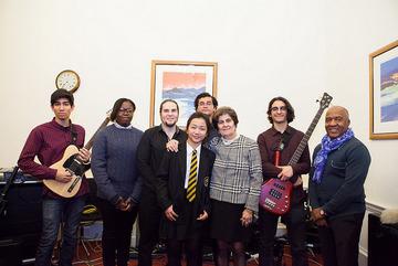 Pinky Lilani CBE DL with students from Southfields Academy